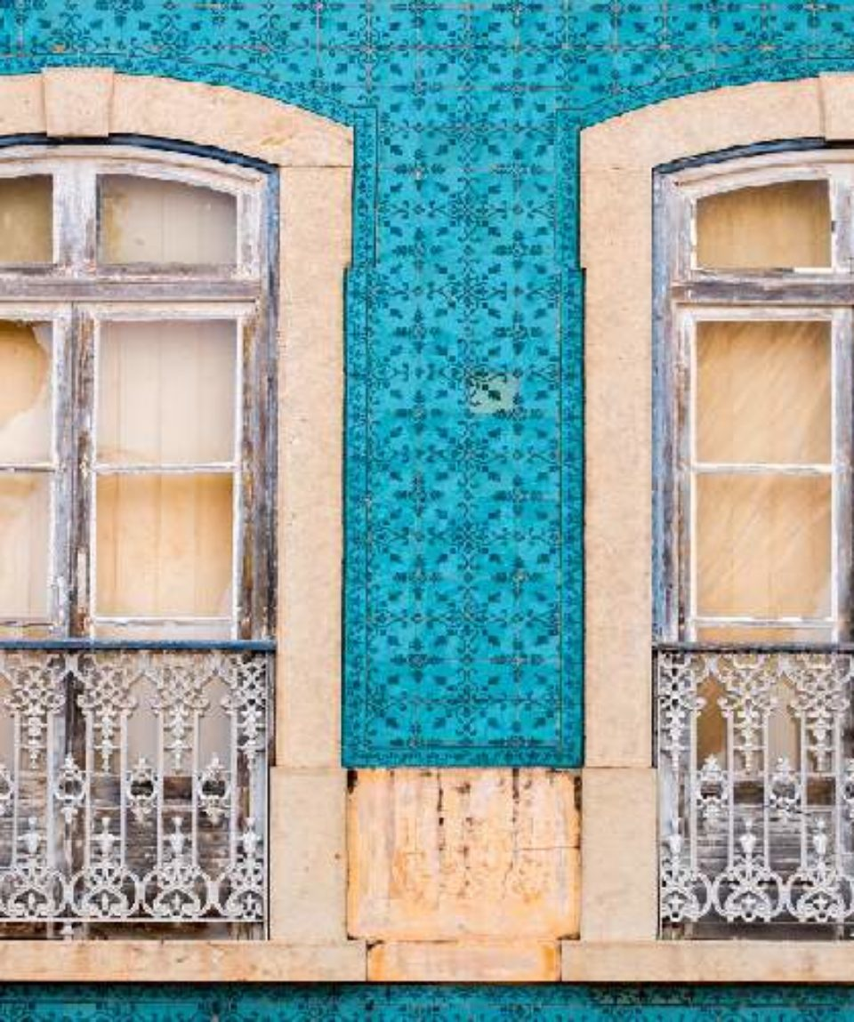 traditional windows of vintage portuguese buildings