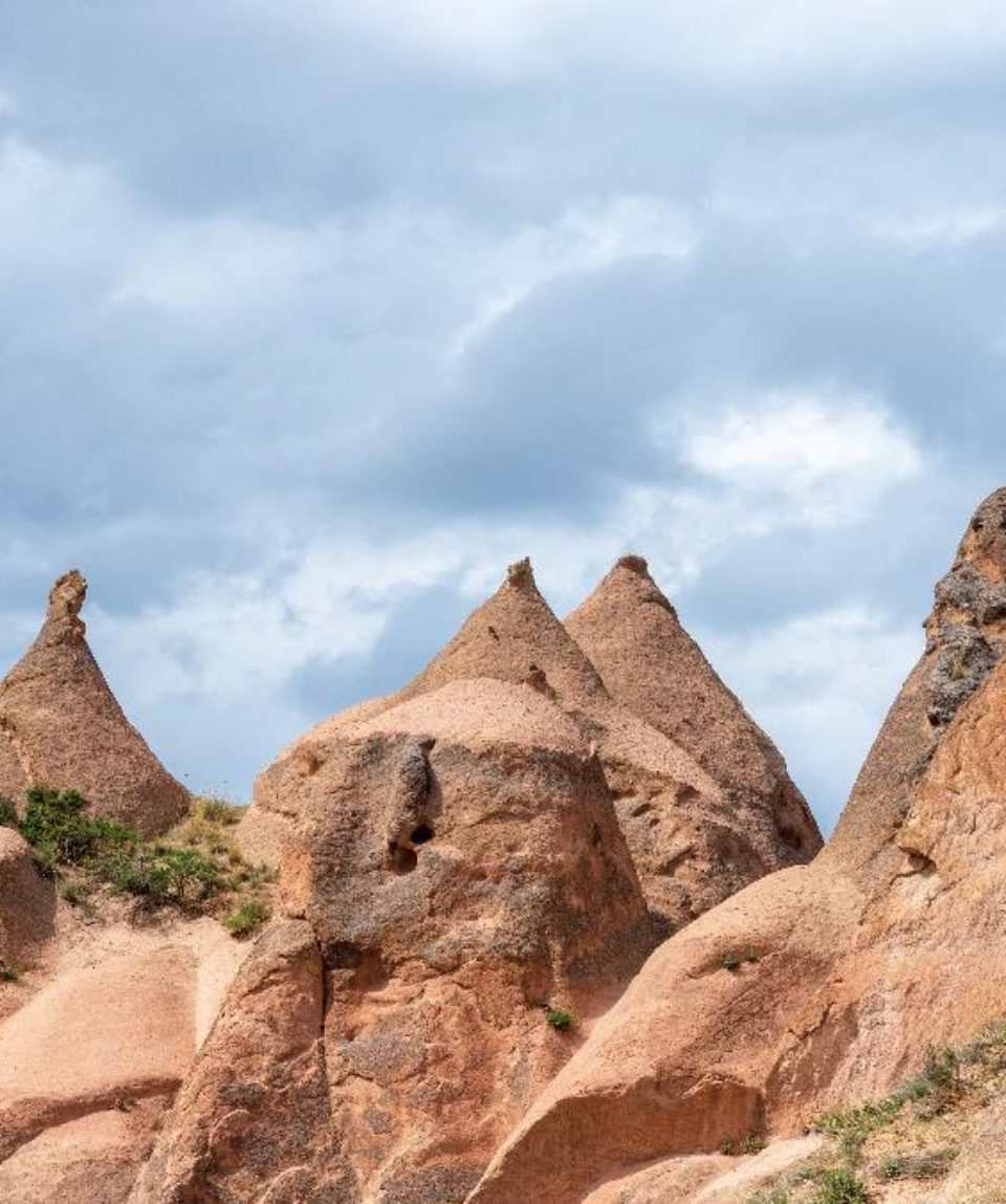 Rock formations and cave town in Zelve Valley, Cappadocia, Turkey